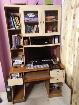 Computer table with books cabinets and drawers