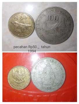 uang logam pecahan Rp50._
