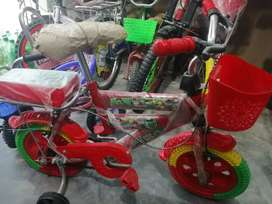 """Kids bycycle, 12"""" and a new model"""