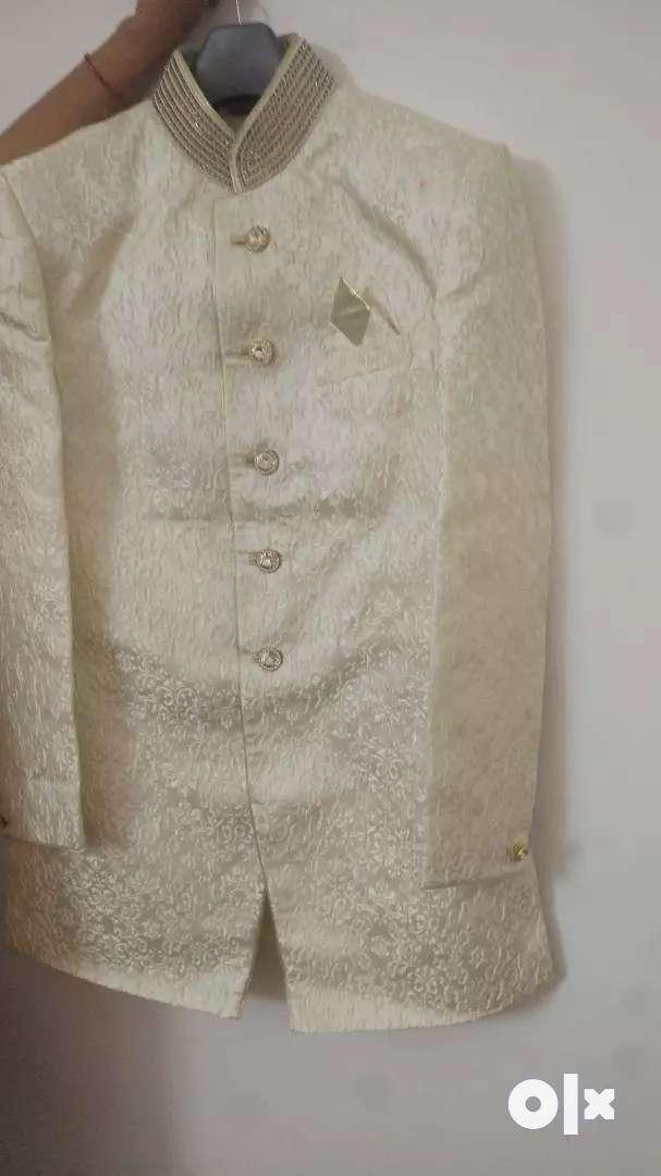 White sherwani with stone work 0