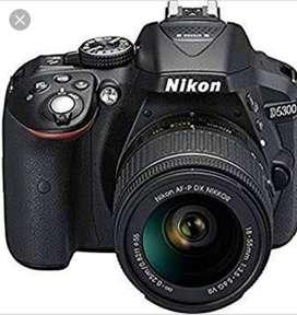 Nikkon D5300DSLR camera with lense &tripod