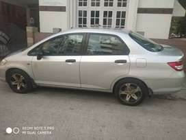 Honda city with good music system and mag wheels with tubeless tyres