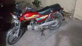 Honda CD-70 Islamabad number Red color.