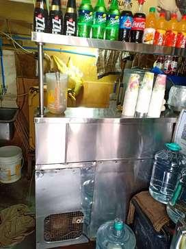 Juice making platform with double door cooler