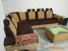 corner sofa set,  centre glass table very good condition (2 years old)