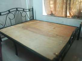 Iron bed with plywood planks in good condition