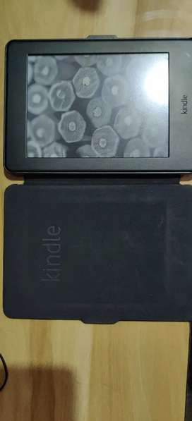 Kindle paper white 7th generation with 4gb storage  cover (negotiable)
