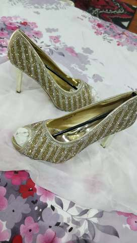 Studded high heel durable shoes.