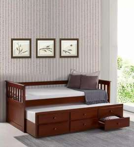 Wood Colour Bed With pull out Single Bed And 3 Storage Draws under It.