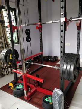 Home Gym setup with weights, mat, bench
