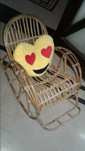 A wooden cane baby ROCKING CHAIR