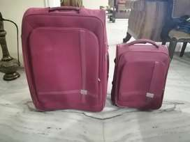 VIP Suitcase Set of 2 Luggage in Pink.