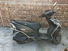 New brand scooty, singal handed driven,in grey colour, smooth sound