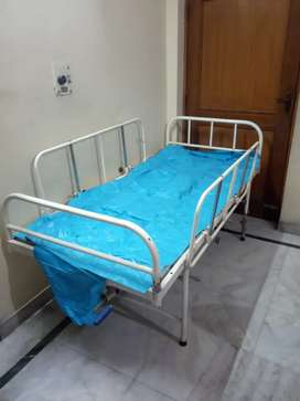 Patient bed with side stand and air mattress