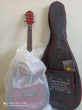 Trinity's red semi aucostic guitar