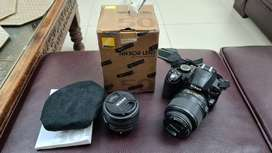 Nikon d3100 with 18-55mm f3.5-5.6g lens and Nikkor 50mm f1.8g lens