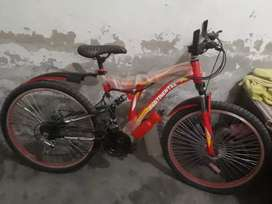Mountain bike bicycle with suspension shaks and Gears