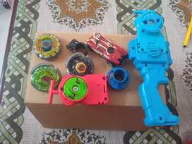 3beyblades with launcher and hotwheels car
