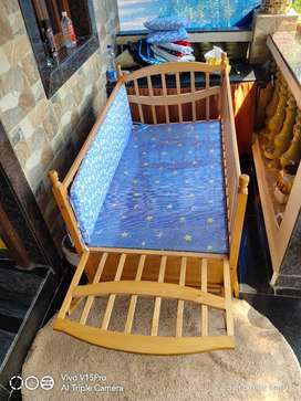 Baby cot well used it can be used at the age 7 also