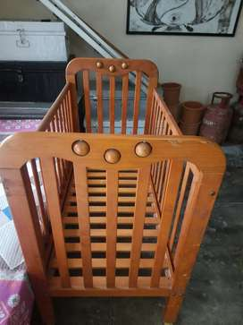 A wooden baby crib