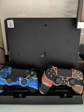 PS4 Slim 1TB with 2 Controllers(one brand new) and PS4 Stand+charging