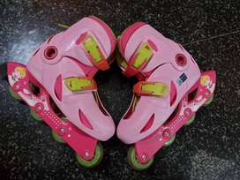 Skating shoes and protection gears for 5 to 8 years.