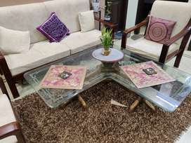 Living room wooden center table with glass top