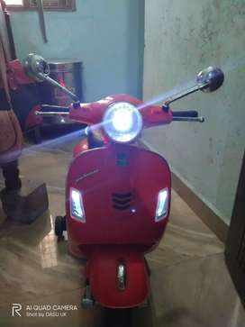 Toy vespa scooty