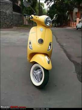 Vespa yellow colour in good condition as new wit