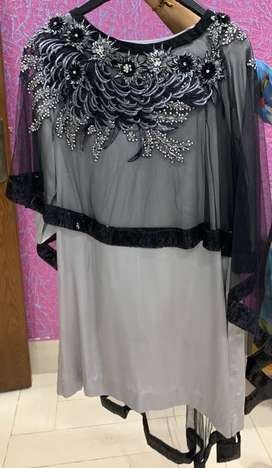 Black net embroided cape, silk grey shirt with black jamawaar trouser.