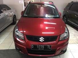 Suzuki Sx4 mt 2013 merah maroon mulus siap pakai