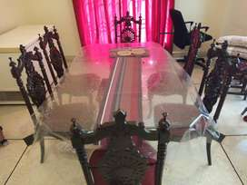Glass top dinning table with 6 chairs