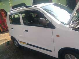 White color WagonR taxi number hai