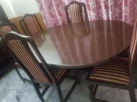 1 year used dinning table with 6 chairs