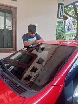 Kaca film pelindung interior mobil anda