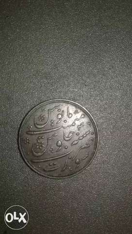 Round Silver-colored Coin.its 1210 ieswin