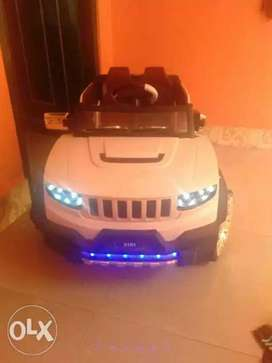 White And Blue Ride On Toy Car