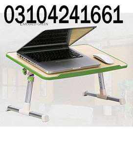 Laptop Table With Cooling Fan tool at hand for debugging circuit desig