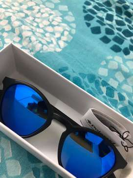 Orginal Polaroid sunglasses, unused and flawless.