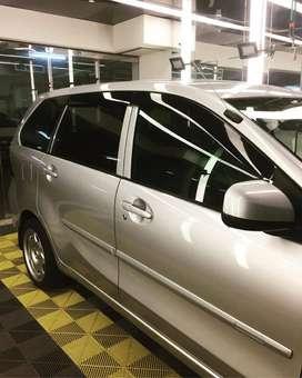 Kaca film penolak sinar SUV