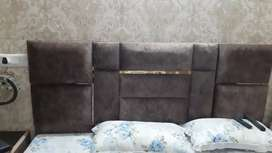Double bed with side tabel