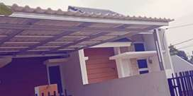Kanopi baja ringan dengan atap Alderon dobel layer/twinwall