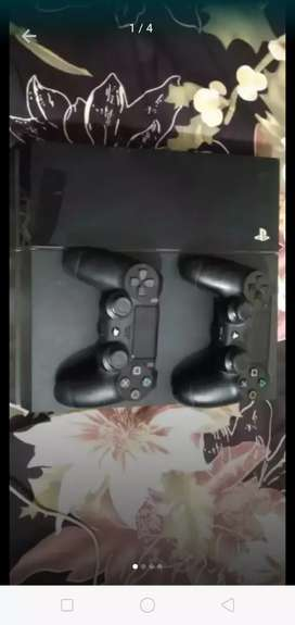PlayStation 4 WITH 2 CONTROLLERS.