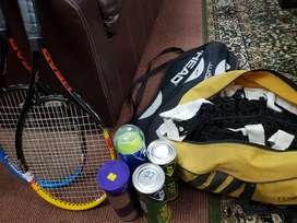 Pair of tennis Rackets with 4 dozen new balls and a net