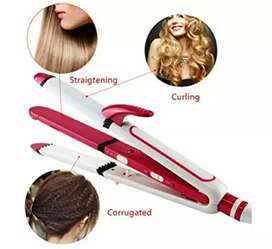 Hair straightener. Straight curly crimping hair styling.