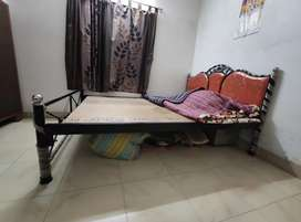 Queen size bed made of iron bars