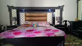 king size bed with sidetables,dressing table and a chair