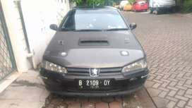 Peugeot 406 tahun 1997 .