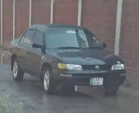 Corolla 12 valve Black color Lahore registered