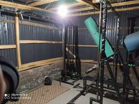 Smith machine cross cable with iron weight and bench leg press chest